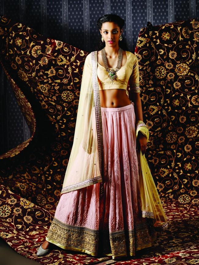 The Nalika lehenga, Rachna earring and Swarnapanna necklace by Anita Dongre