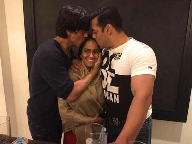 Mumbai: Actors Shah Rukh Khan and Salman Khan bless Arpita Khan on her mehndi ceremony in Mumbai, on November 16, 2014. (Photo: IANS)