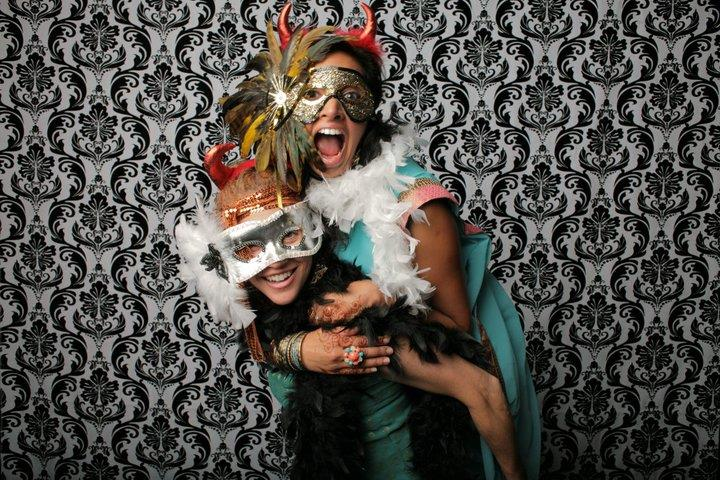 indian wedding photo booth with damask print background