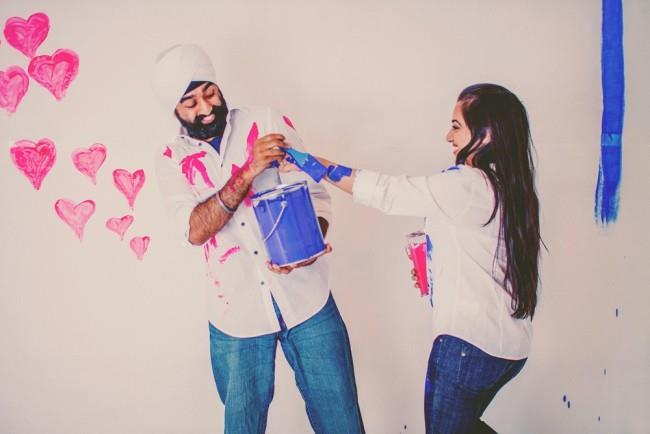 3 indian engagement shoot painting on eachother
