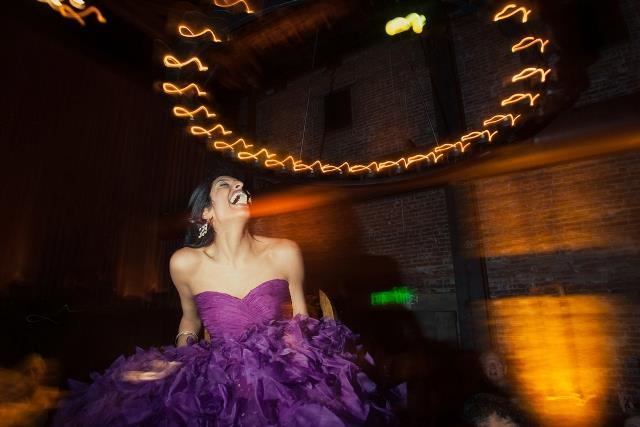 AS12-Indian-bride-dancing-at-reception-in-California-in-purple-dress