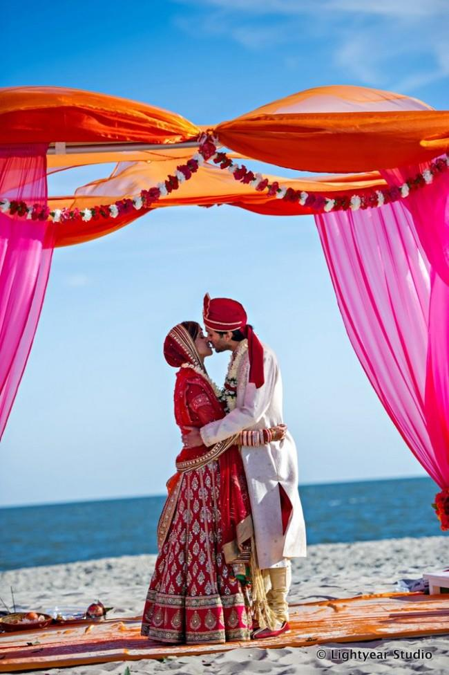 Couple kissing in outdoor beach portrait