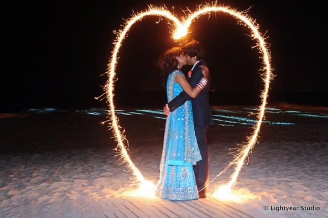 heart fire crackers with couple inside