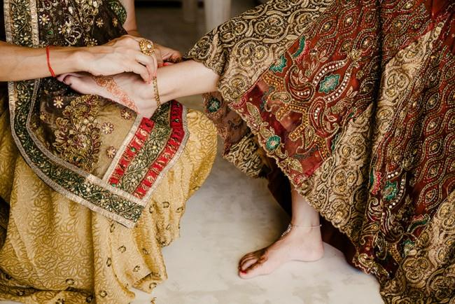 3a- bride putting on payal