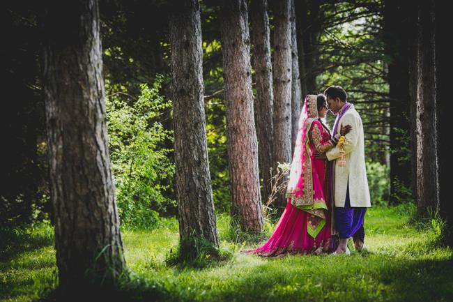 outdoor indian wedding portrait pink bridal lengha