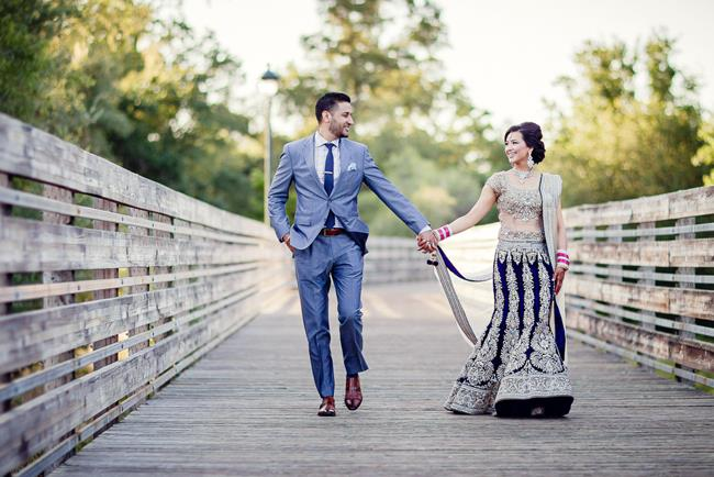 Bride and groom portrait with royal blue lehnga