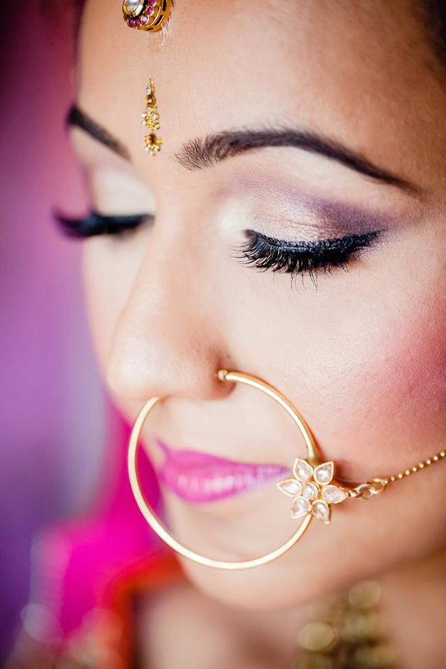 Closeup of Indian bride makeup and gold round nose ring nath