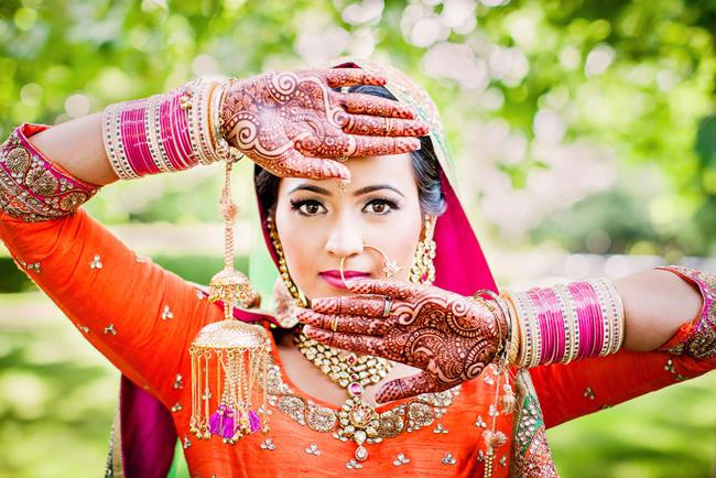 Portrait of Punjabi Indian bride with kaleeray churra and mehndi