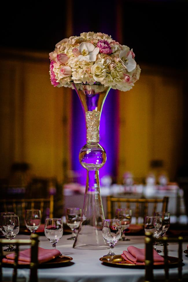 Tall Indian wedding centerpiece with blush pink flowers