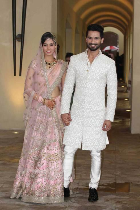 shahid-kapoor-and-mira-rajput-kapoor-first-look-at-newlyweds-baby-pink-lehenga-with-embroidered-flowers-shahid-kapoor-mira-rajput-wedding