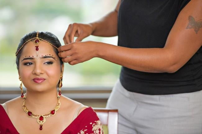 1 indian bride getting ready red jewelry